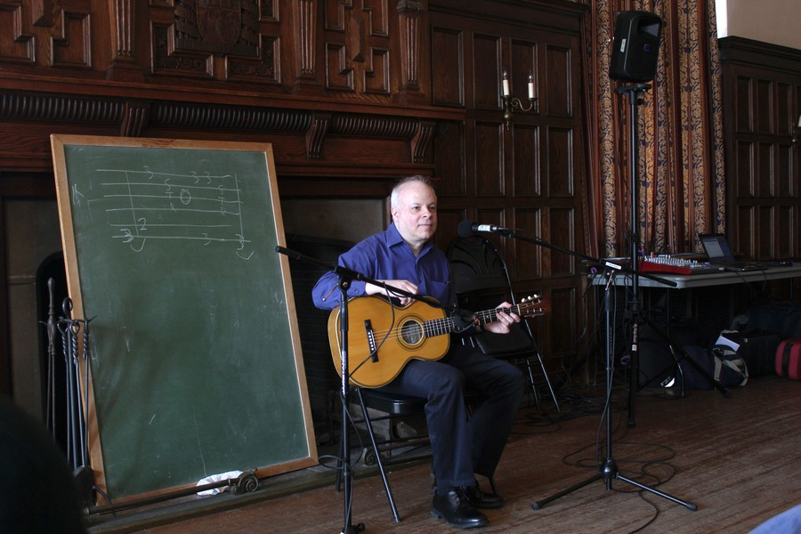 Ari Eisinger leads a workshop on the guitar style of blues musician Blind Blake.