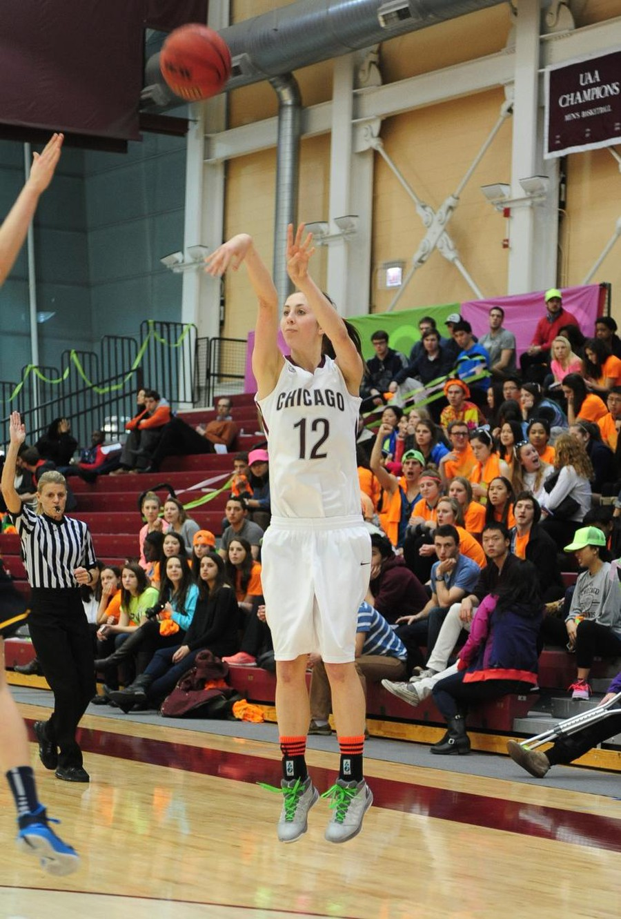 Fourth-year forward Ellie Greiner shoots a three pointer against the University of Rochester at Neon Night earlier this year.