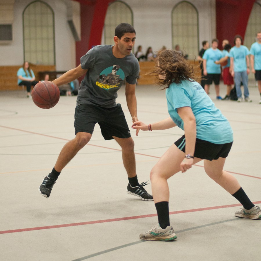Henderson House faces off against Thompson House in basketball.