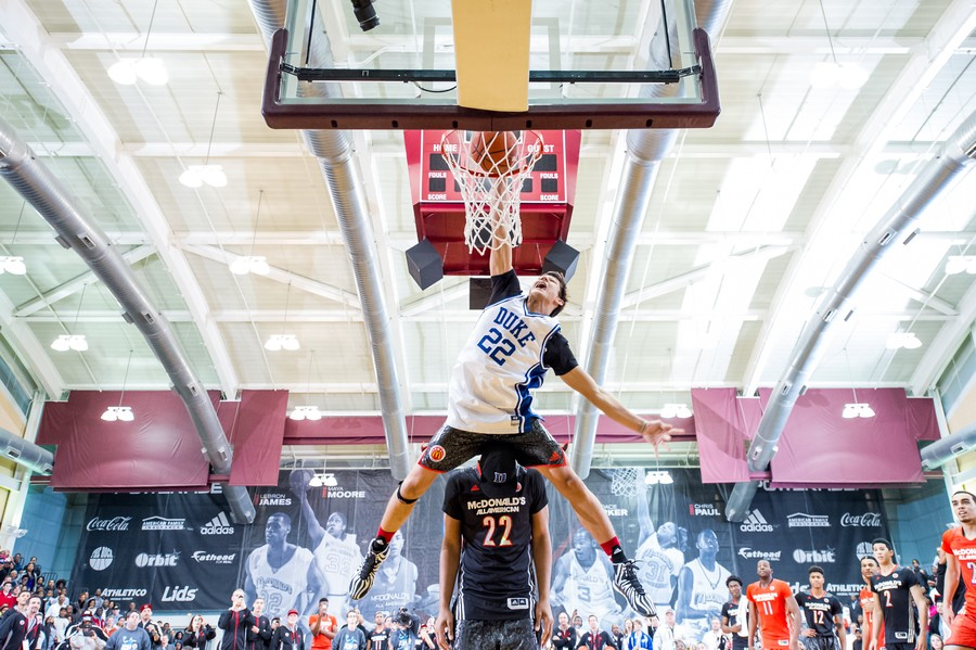 McDonald's All-American Grayson Allen leaps over 6-foot-10 Jahlil Okafor in the dunk contest portion of the Jam Fest at Ratner last Monday night.