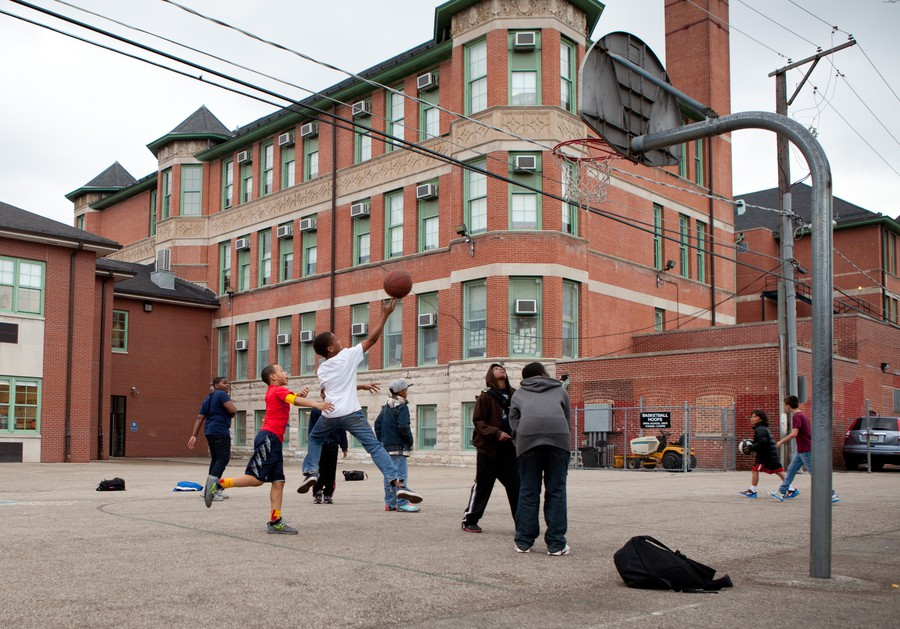 Students from Ray Elementary School play pick-up basketball after school.  Due to Chicago Public School closings in the upcoming months, Ray will gain students from Canter Middle School.