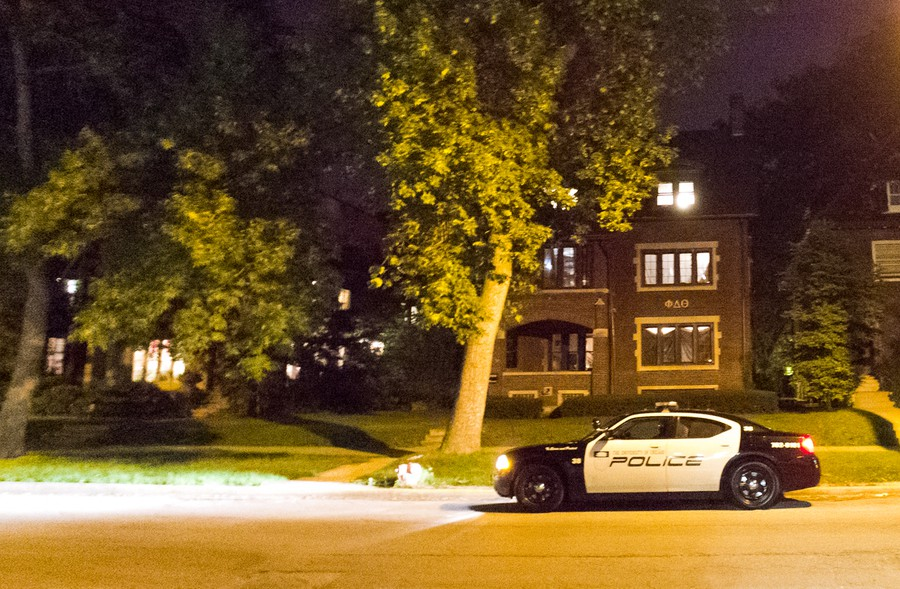 A UCPD squad car sits outside of Phi Delta Theta Thursday evening after the fraternity received a bomb threat. The fraternity says that it is the victim of an anti-gay and racist prank.