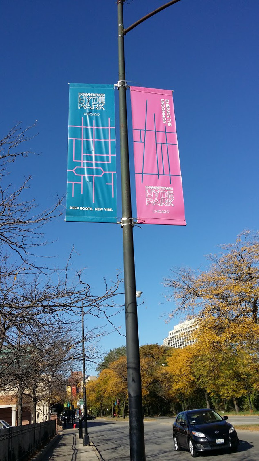 """New banners on 53rd Street read """"Embrace the Uncommon,"""" and """"Deep Roots. New Vibe."""""""