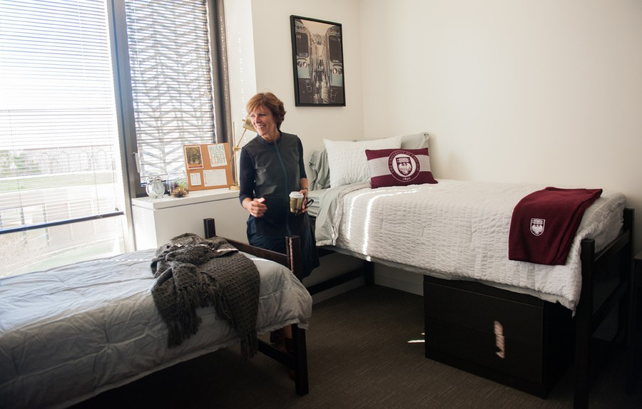 Jeanne Gang, the architect behind the campus's new dorm, sits in a Campus North bedroom.