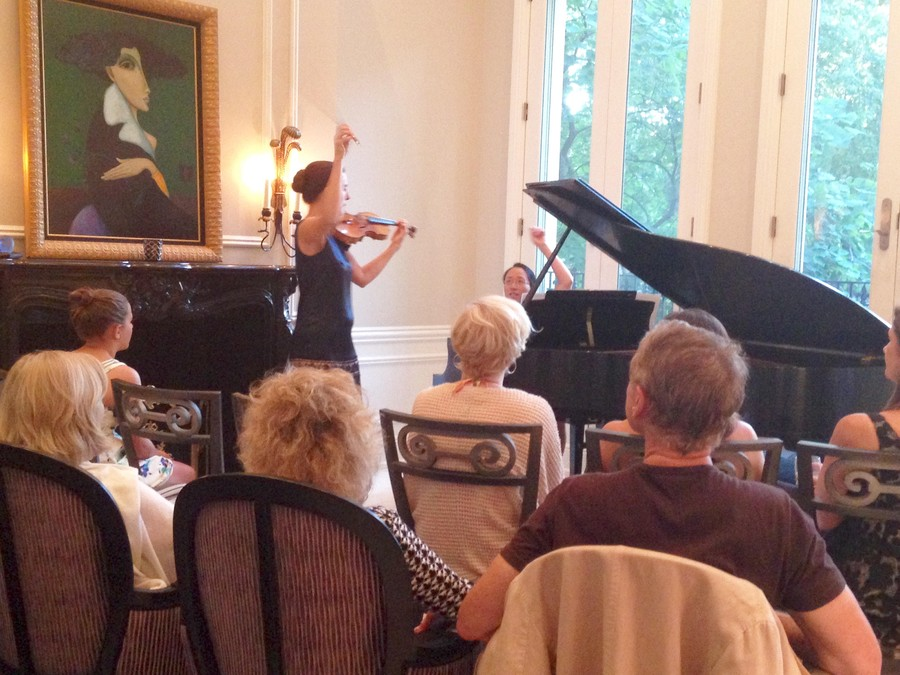 Alison Dalton at her solo recital this summer, accompanied by Eugenia Cheng, a math lecturer at the University of Chicago.