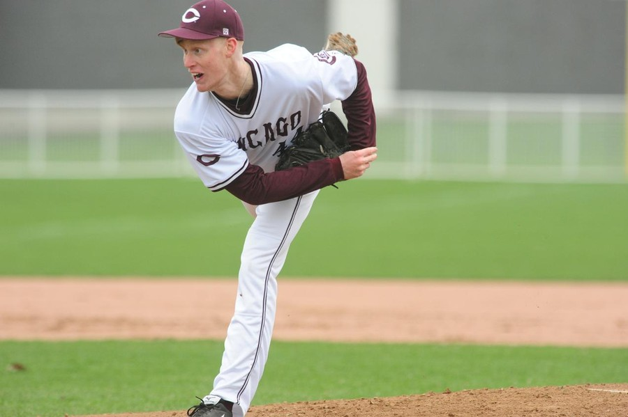 Fourth-year  Nick Watson pitches in a game against Edgewood College last year.
