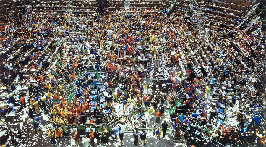 """Andreas Gursky's """"Chicago Board of Trade II"""", 1999. The artist is shown in the third row, second from left."""