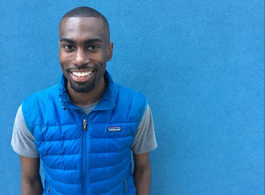Black Lives Matter Activist DeRay McKesson wearing a blue Patagonia down vest, which has become his signature outfit.