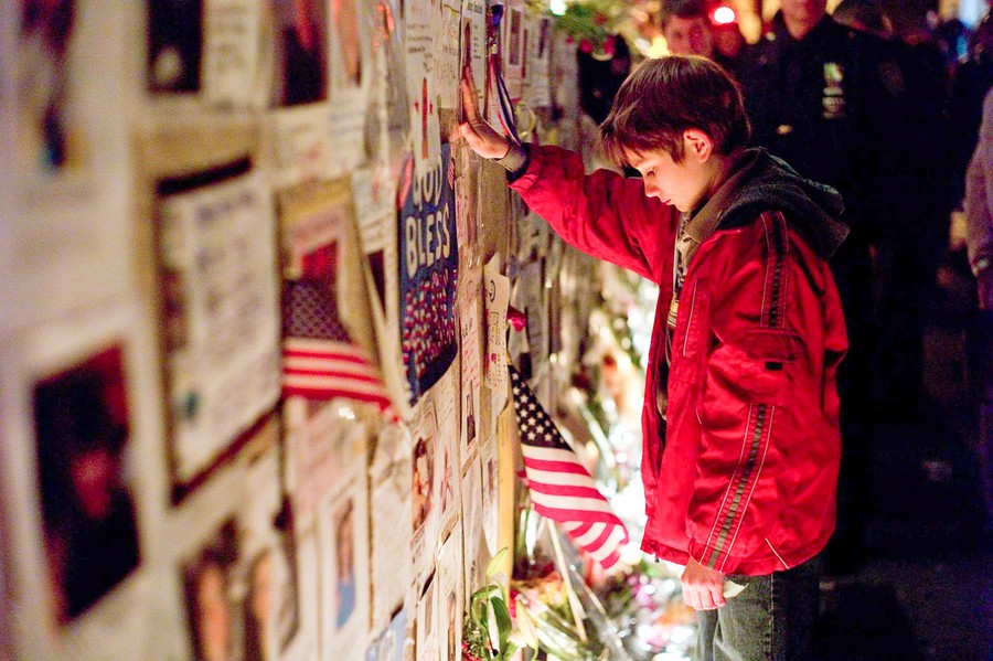 Thomas Horn, surrounded by posters of the missing, takes a moment of silence.