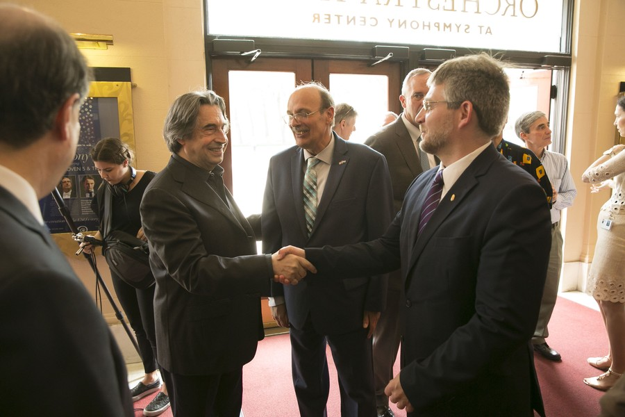 Riccardo Muti praises Reiner's legacy next to the Symphony Center's new bronze likeness of the maestro.