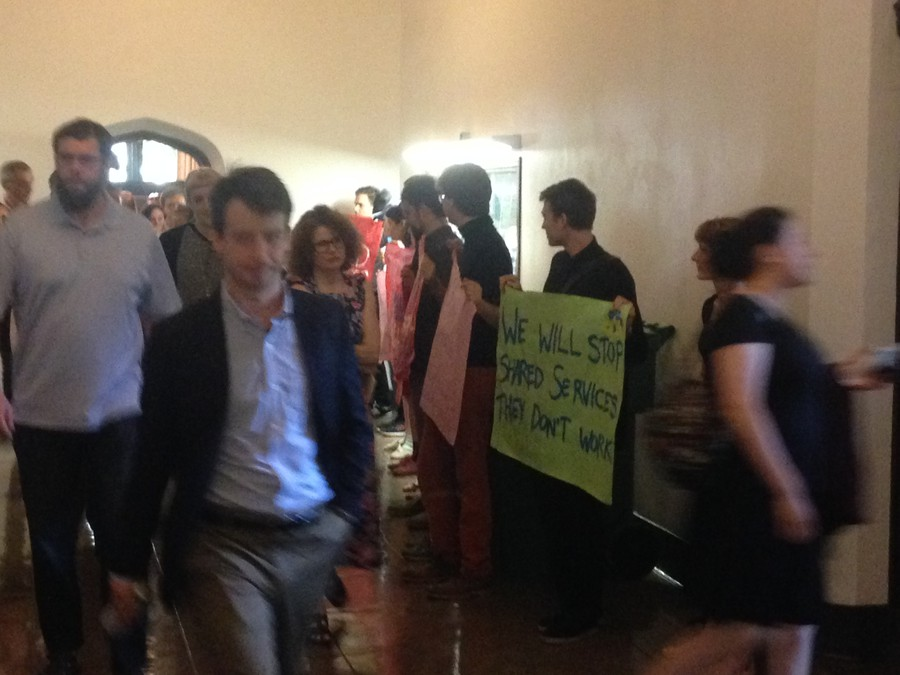 Activists associated with  the IIRON Student Network  and GSU protested the budget cuts outside a May 31 staff meeting.