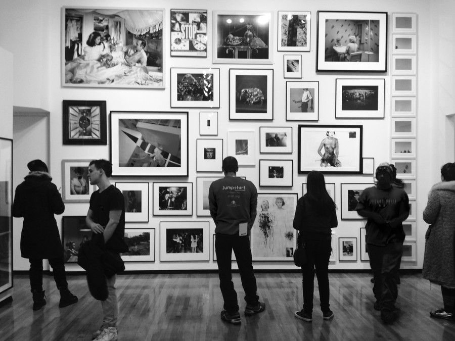Visitors peruse the main floor of the Museum of Contemporary Photography's latest exhibition, MoCP at 40, which debuted on January 25 and will run through April 10.