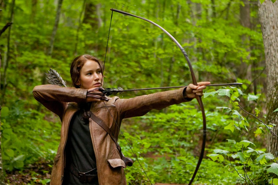 Jennifer Lawrence as Katniss Everdeen goes in for the kill in The Hunger Games.
