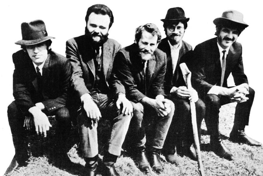 The Band's All Here: original lineup Richard Manuel, Garth Hudson, Levon Helm, Robbie Robertson, and Rick Danko sit together, 1969.