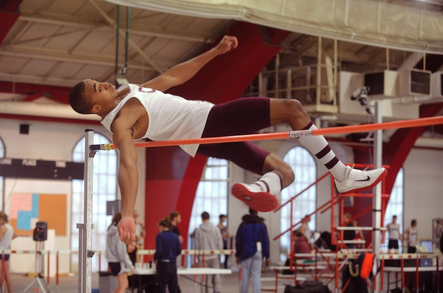 Third-year Semi Ajibola competes in the high jump during a meet last season.
