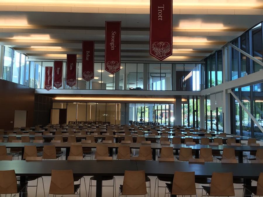 New house banners above house tables in Baker Dining Commons.