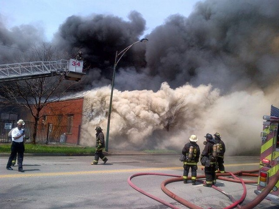 More than 130 firefighters were called to battle a fire in an abandoned factory building at 6800 South Cottage Grove Avenue early yesterday afternoon. The one-story, 200-by-200-foot building caught fire at around noon, prompting a 3-11 alarm, which indicates that a higher-than-normal amount of resources and crewmembers was needed to contain the fire. The fire was declared under control at 1:15 p.m., according to Chicago Fire Department Chief Kevin MacGregor. In response to the fire, the #4 Cottage Grove bus was temporarily rerouted. No injuries were reported..