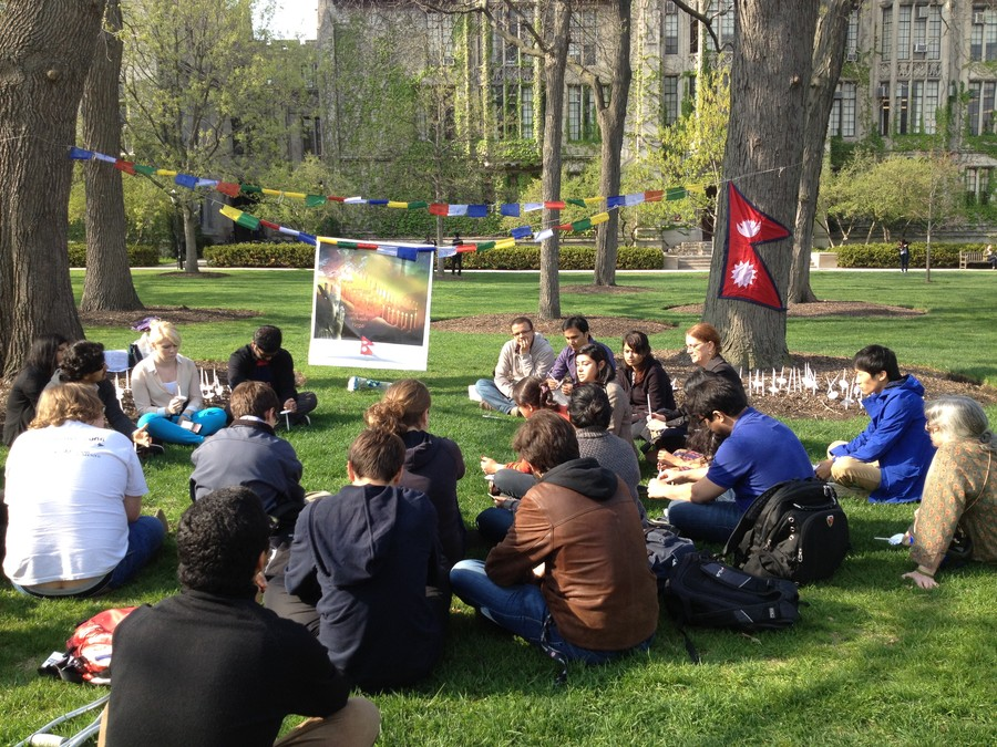 Members of the University community hold a vigil for victims of the Nepalese earthquake on the Main Quad.