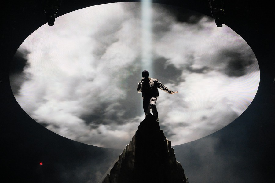 Kanye West, high on the mountaintop in Madison Square Garden. On belay? Belay on. Spotters ready.