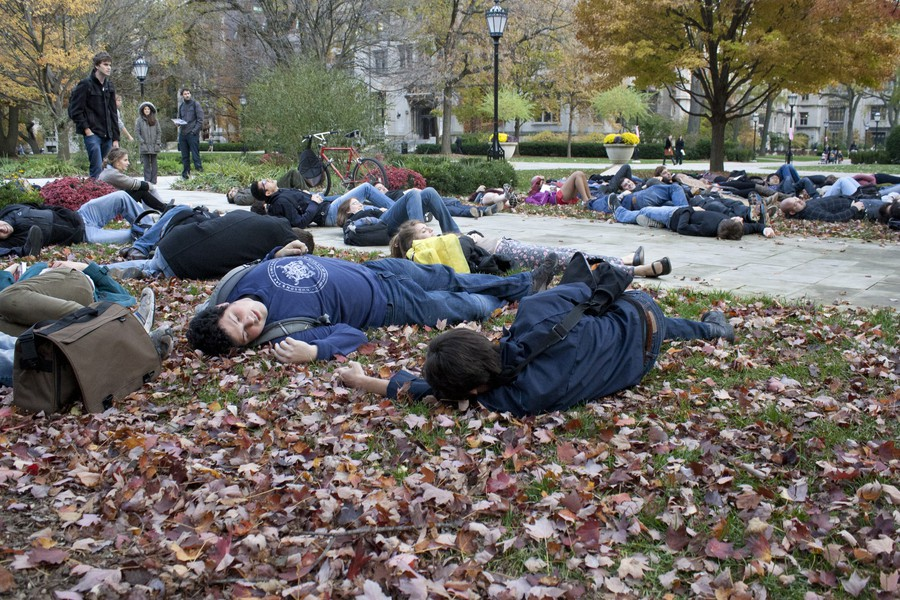 "Students stage a ""die-in"" on the quads in protest of the University of Chicago Medical Center's refusal to open an adult level-one trauma center."