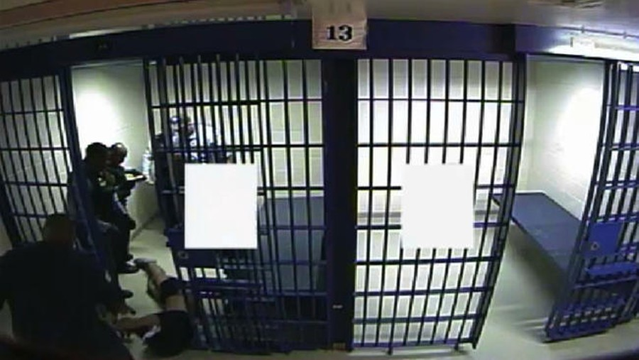 A still from a recently released video shows Philip Coleman, (A.B. '96) being removed from his cell by Chicago police officer. Coleman died hours later.