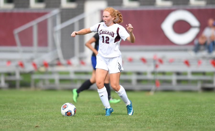 Jenna McKinney makes her mark as she races up the field with the ball in the midst of opposing defenders.