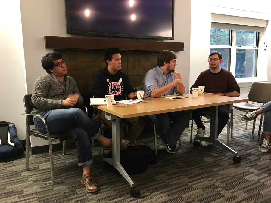 From left to right: Second-year Anil Sindhwani, second-year Patrick Lou, and third-year Mike Dewar participate in a debate moderated by fourth-year David Abraham on trigger warnings and safe spaces sparked by a letter sent out to the Class of 2020.