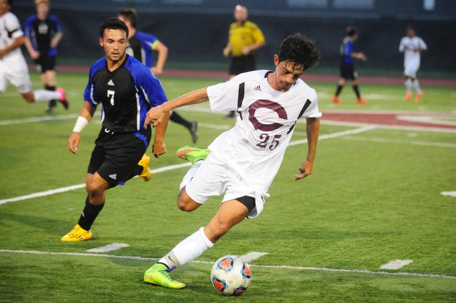 Second-year Juan Barrero attempts to kick the ball up the field.