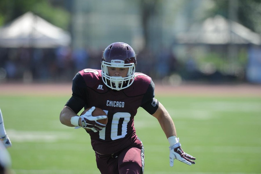 Third-year running back Chandler Carroll carries the ball for the Maroons.