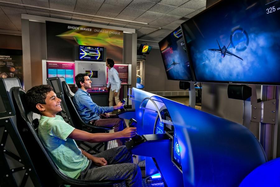The exhibit features multiple simulators.