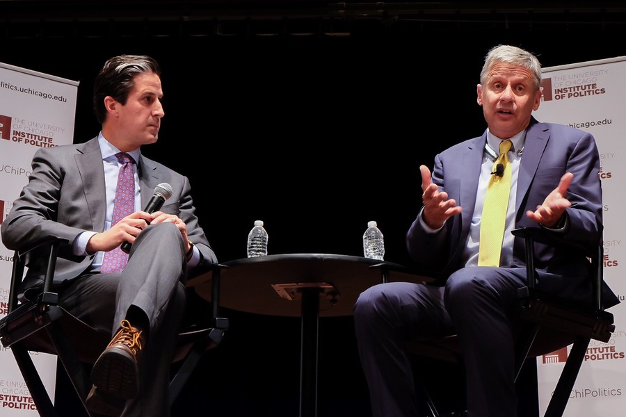 Gary Johnson speaks with Steve Edwards at the I-House Assembly Hall.