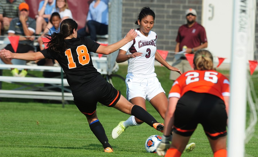 Kelsey Moore avoids a defender as she dribbles up the field.