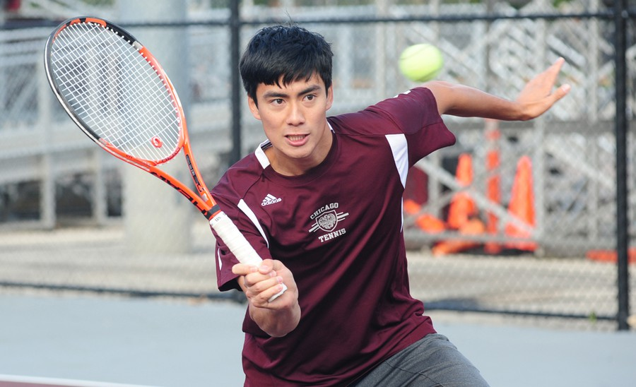 Third-year Peter Leung connects with a volley.