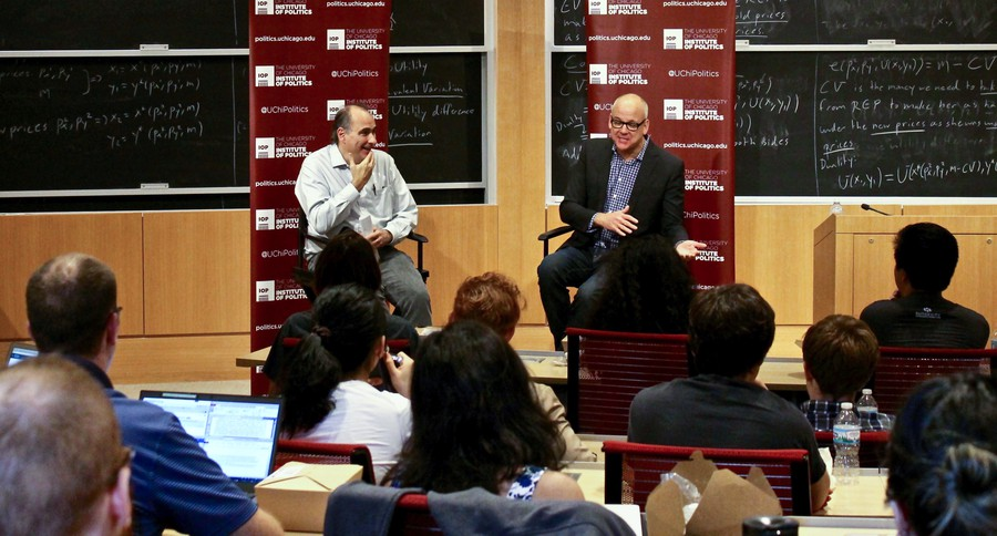 Institute of Politics director David Axelrod (left) and co-managing editor of Bloomberg Politics, John Heilemann, discuss the 2016 presidential election at Saieh Hall on Oct. 17.