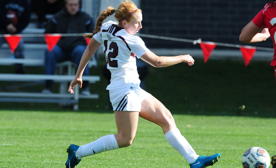 Second-year midfielder Jenna McKinney dribbles the ball past a defender.