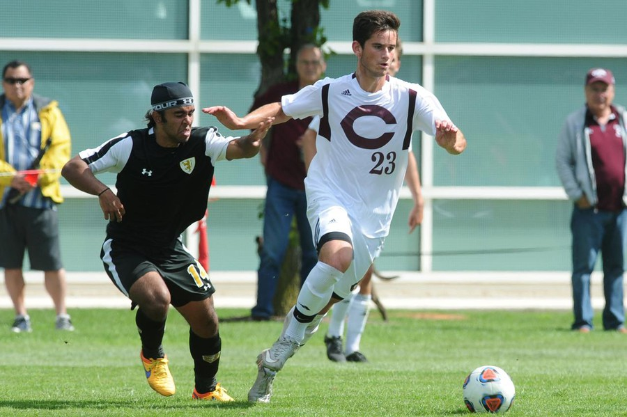 Third-year Andre Abedian runs past chasing defender and moves the ball up the field.