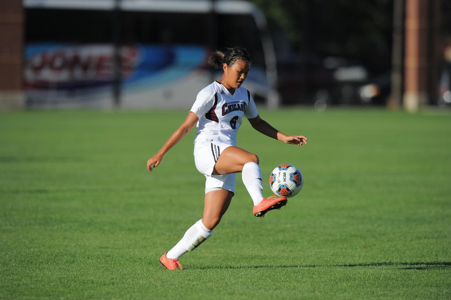 Fourth-year Sophia Kim taps the ball to herself as she gains possession.