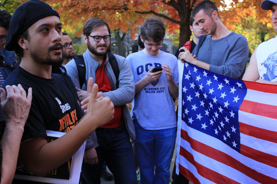 Students brought an American flag to Diaz's protest.