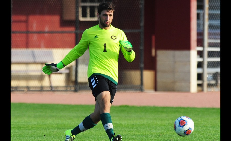 Third-year goalkeeper Hill Bonin passes a ball to his defenders