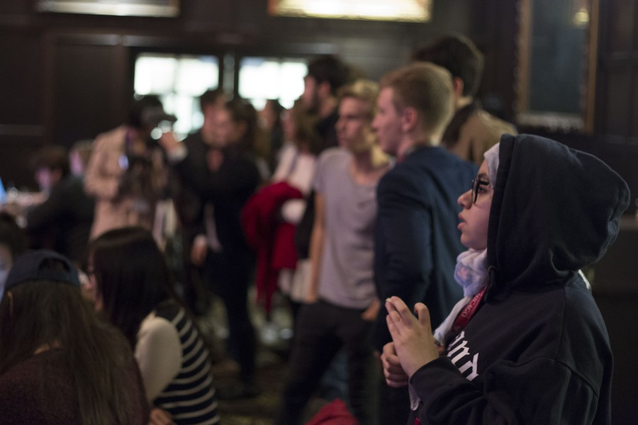 A student watches CNN's election coverage in Reynolds Club at the IOP watch party.