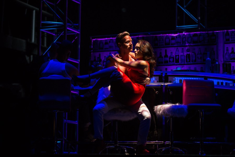 Lysander (Ryan Belongie) and Helena (Alexandra Martinez) share an intimate embrace.