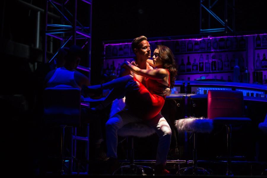 Lysander (Ryan Belongie) and Helena (Alexandra Martinez) share an intimate embrace.