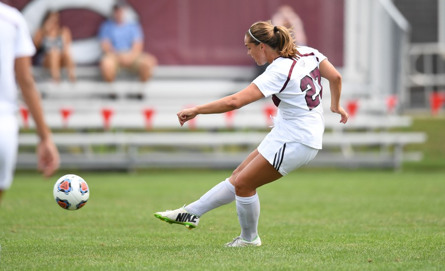 Third-year forward Mia Calamari takes her boot to the ball.