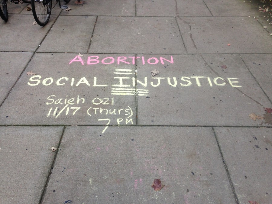 An advertisement for the anti-abortion event was chalked near the Social Science Research Building.