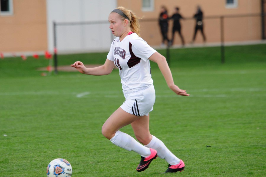 Whitley Cargile sprints up the field with great intent and focus.