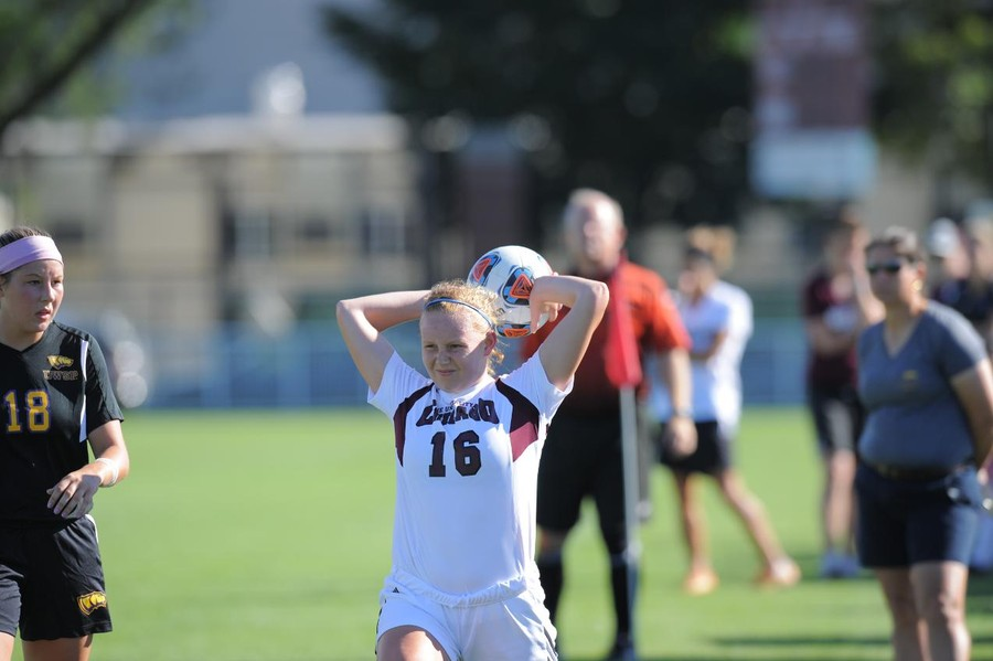 Third-year defender Whitley Cargile throws the ball in to her teammate.