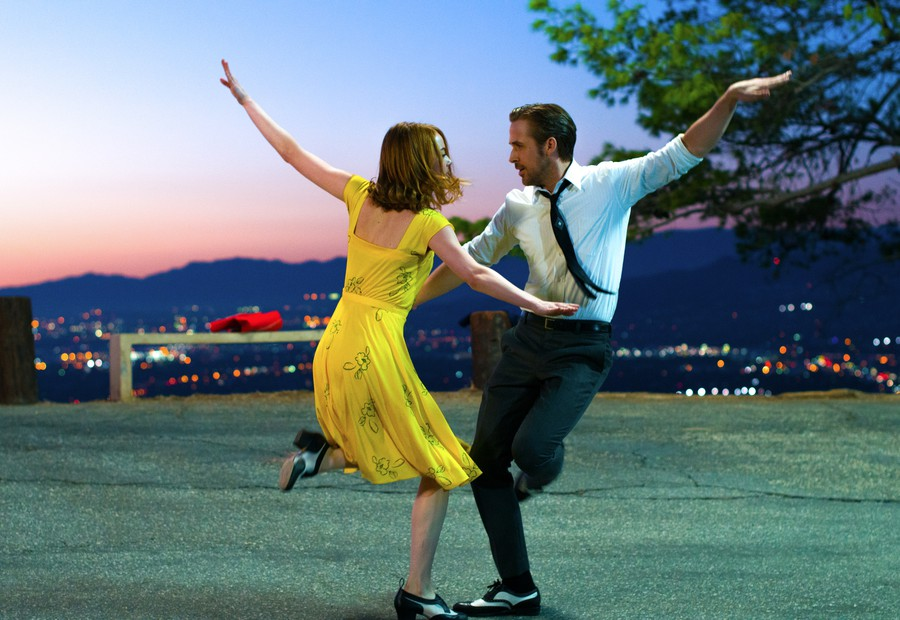 Mia (Emma Stone) and Sebastian (Ryan Gosling) dance in a scene from La La Land.