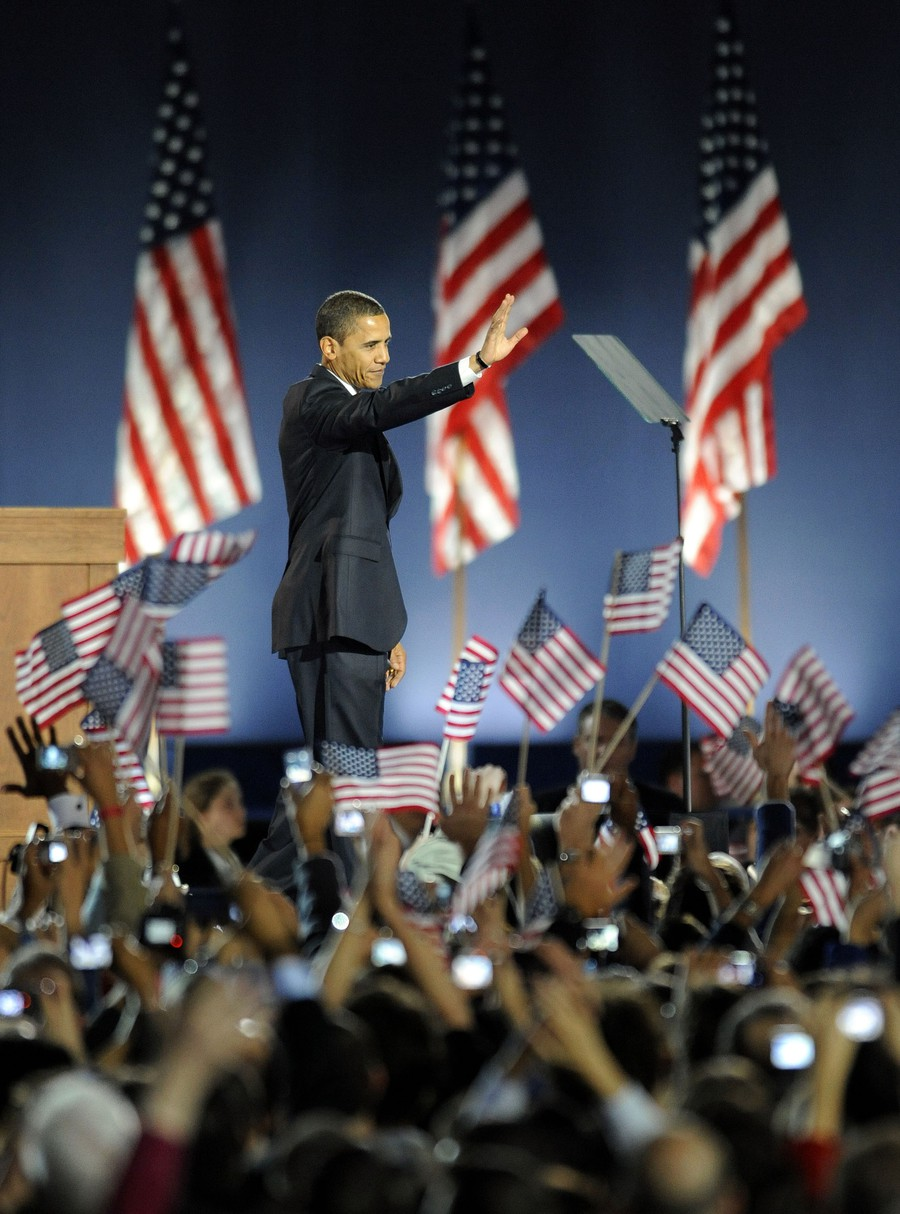 Barack Obama waves to the crowd during his election night victory speech in Chicago.