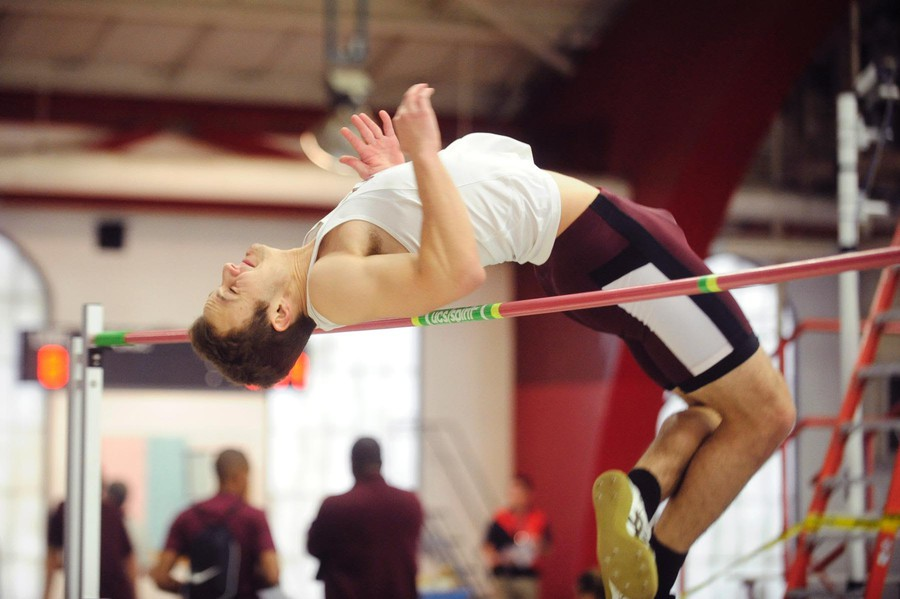 Third-year Will Ackerman vaults over the bar.