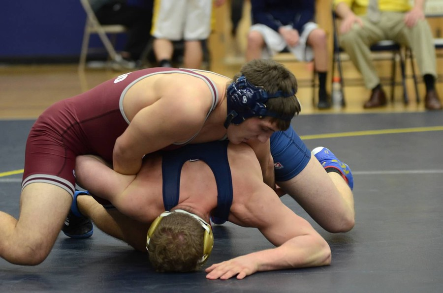 Third-year Nicholas DiNapoli pins down his opponent effortlessly.